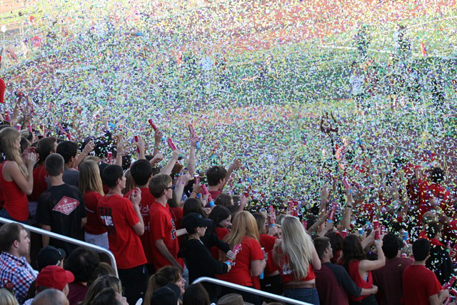 fans stand and cheer as confetti fills the stadium at PVHS